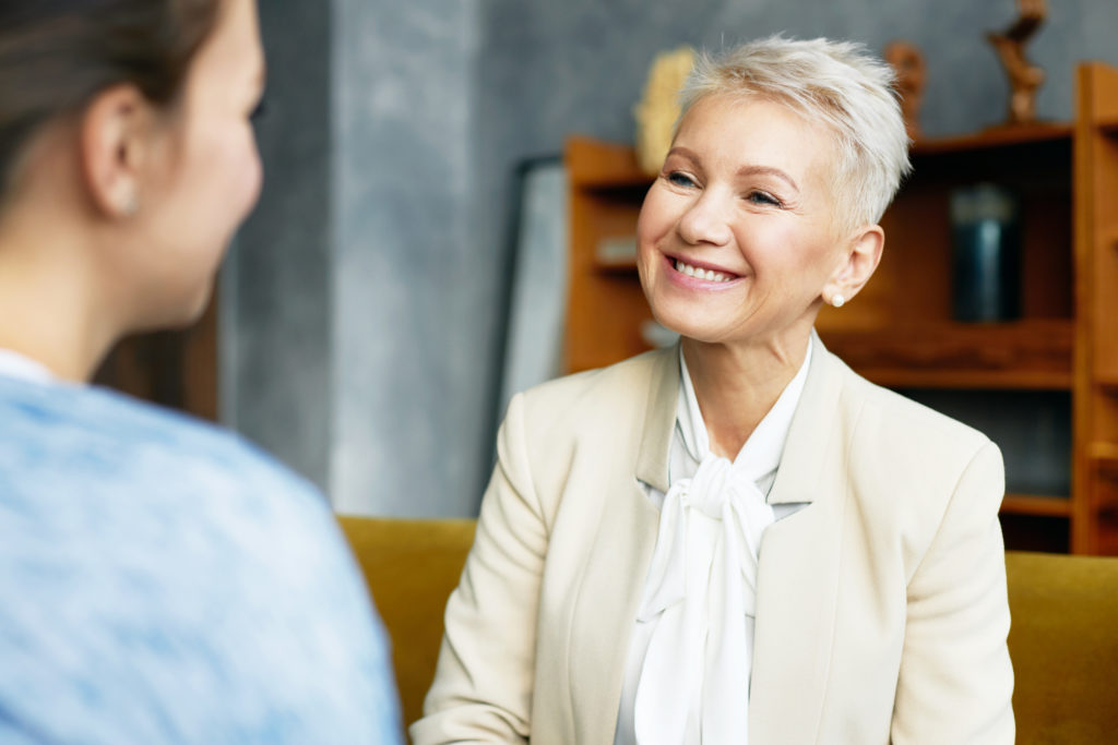 Smiling woman depicting a therapist